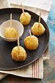Arancini on wooden skewers