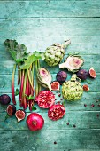 Still life with rhubarb, artichokes, pomegranate and figs