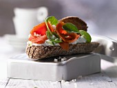 A wholegrain salmon sandwich with cucumber quark and spinach