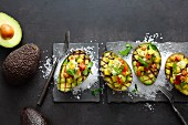 Grilled avocado halves with pineapple and monkfish ceviche