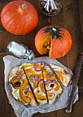 Tarte flambée with pumpkin and onions