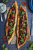 Turkish pide made with spiced lamb, ganished with chillis and fresh coriander, view from above