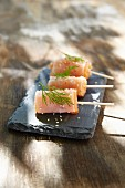 Radish and salmon rolls with sesame