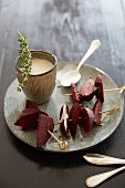Beetroot skewers with a light sauce