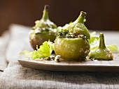 Baked figs filled with fresh cheese and pistachios