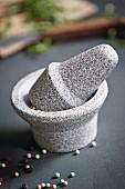 A ceramic mortar and pestle