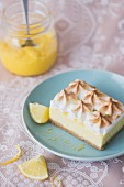 Slice of lemon cheesecake with meringue