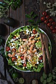 Sweetcorn salad with grilled prawns, tomatoes and feta