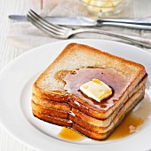 Golden brown french toast with syrup and butter