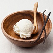 Vanilla ice cream in wooden bowl