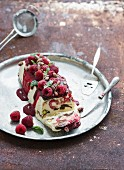 Semifreddo or italian cheese ice-cream dessert with pistachios, fresh raspberries and mint on vintage silver tray