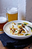 Cauliflower and bean soup with beer