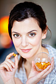 Woman taking food supplement