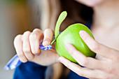 Woman peeling an apple