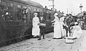 Nurses and soldiers at a train station, World War I
