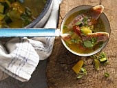 Red mullet in vegetable soup with saffron and fennel