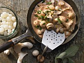 Mushrooms in cream sauce with chives and sage