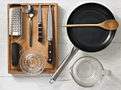 Kitchen utensils for making fish goulash with vegetables