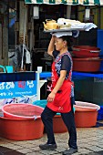 A woman on the fish market in the Nampo District, Busan, South Korea, Asia