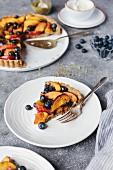 A slice of peach and blueberry tart