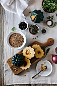 Ingredients for Roasted Acorn Squash Salad with Farro are displayed on a farm style board