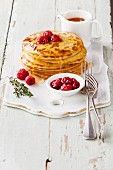 Small pancakes topped with raspberries