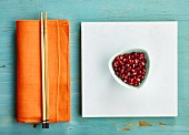 Pomegranate seeds with minimalist styling