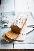 Pumpkin cake with icing sugar, sliced