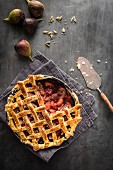 Fig cardomom apple and raspberry pie with fresh figs cardomom and serving slice