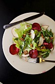 Apple, greens, red beet and walnut salad with buttermilk dressing