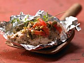 Italian chicken in foil with tomatoes, capers and oregano