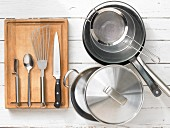 Various kitchen utensils: pot, pan, sieve, spatula