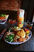 Nasi lemak (chicken curry, coconut rice, sambal ikan bilis, slow poached egg)