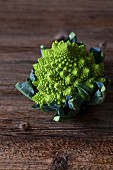 Head of Romanesco broccoli on a rustic wooden table