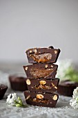 Stack of Chocolate cups filled with date caramel
