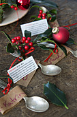 Spoons with name tags, holly and horoscopes for Christmas