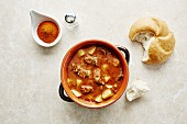 Goulash soup with potatoes and bread rolls