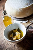 Cheese with olive oil in a bowl