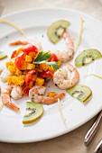 Shrimp with pumpkin cubes, cherry tomatoes and kiwi slices