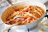 Linguine with tomato sauce in a pan