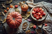Pumpkins and autumn leaves on wooden table