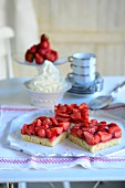 Three pieces of strawberry cake with whipped cream