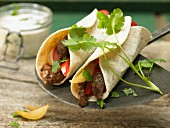 Tortilla wrap with beef and strips of red pepper