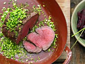 A herb and spice-crusted filet of beef