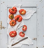 Fresh ripe hairloom tomatoes on rustuc blue wooden surface