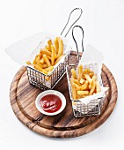 French fries in baskets for serving on white background