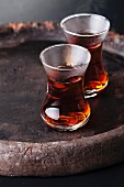 Hot tea in Turkish tea cup on dark background