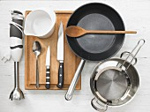 Various kitchen utensils: blender, pan, pot, strainer, mixing jug