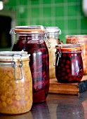 Preserving jars of various stewed fruits