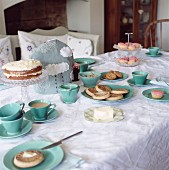 A table laid for afternoon tea and crumpets